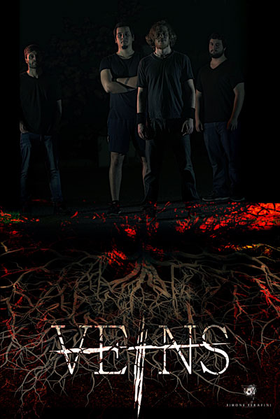 picture depicting the lineup of the Death Thrash Metal band Veins from Rome, Italy. It shows all the four members standing over the logo of the band.